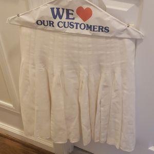 White pleaded skirt